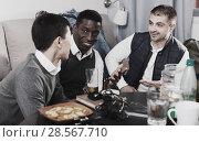 Купить «Males friendly meeting over beer», фото № 28567710, снято 23 февраля 2018 г. (c) Яков Филимонов / Фотобанк Лори