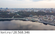 Купить «The panoramic bird's eye view shooting from drone of the Podol district, the right bank of the Dnieper River and centre of Kiev, Ukraine at summer sunset on the background of the cloudy sky.», фото № 28568346, снято 15 апреля 2018 г. (c) Ярослав Данильченко / Фотобанк Лори