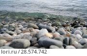 Купить «Fragment of sea coast with a pebble beach», видеоролик № 28574742, снято 5 июня 2018 г. (c) Володина Ольга / Фотобанк Лори