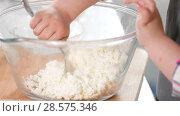 Купить «Little girl crumple cottage cheese with a fork in a glass bowl at cooking studio», видеоролик № 28575346, снято 6 апреля 2020 г. (c) Константин Шишкин / Фотобанк Лори