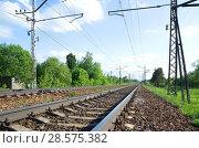 Купить «Железная дорога на фоне весеннего пейзажа», фото № 28575382, снято 22 мая 2018 г. (c) Елена Коромыслова / Фотобанк Лори