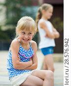 Купить «Small sisters upset after quarrel outside», фото № 28576942, снято 20 июля 2017 г. (c) Яков Филимонов / Фотобанк Лори