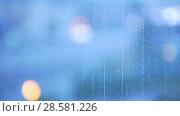 Купить «Rain drops on the window glass - blue tone», видеоролик № 28581226, снято 22 июля 2018 г. (c) Константин Шишкин / Фотобанк Лори