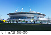 Купить «Saint Petersburg. People go to a sporting match in the new modern stadium St. Petersburg Arena on the Krestovsky Island built to the world football champion, Mundial 2018», фото № 28586050, снято 13 мая 2018 г. (c) Виктория Катьянова / Фотобанк Лори