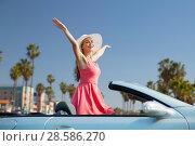 Купить «happy young woman in convertible car», фото № 28586270, снято 17 августа 2017 г. (c) Syda Productions / Фотобанк Лори