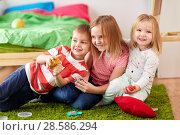 Купить «kids with modelling clay or slimes at home», фото № 28586294, снято 15 октября 2017 г. (c) Syda Productions / Фотобанк Лори