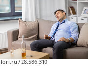 Купить «drunk man with glass of alcohol sleeping at home», фото № 28586310, снято 24 ноября 2017 г. (c) Syda Productions / Фотобанк Лори