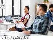 Купить «creative office workers with user interface mockup», фото № 28586338, снято 1 апреля 2018 г. (c) Syda Productions / Фотобанк Лори