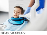 Купить «dentist making x-ray of kid teeth at dental clinic», фото № 28586370, снято 22 апреля 2018 г. (c) Syda Productions / Фотобанк Лори