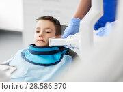Купить «dentist making x-ray of kid teeth at dental clinic», фото № 28586370, снято 22 апреля 2018 г. (c) Syda Productions / Фотобанк Лори
