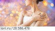 Купить «close up of beautiful woman with finger ring», фото № 28586478, снято 9 апреля 2016 г. (c) Syda Productions / Фотобанк Лори