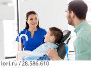 Купить «father and son visiting dentist at dental clinic», фото № 28586610, снято 22 апреля 2018 г. (c) Syda Productions / Фотобанк Лори