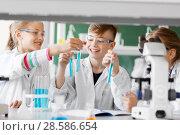 Купить «kids with test tubes studying chemistry at school», фото № 28586654, снято 19 мая 2018 г. (c) Syda Productions / Фотобанк Лори