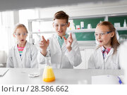 Купить «kids with test tube studying chemistry at school», фото № 28586662, снято 19 мая 2018 г. (c) Syda Productions / Фотобанк Лори