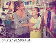 Купить «Woman with girl are choosing goods in chemistry rows», фото № 28590454, снято 5 июня 2017 г. (c) Яков Филимонов / Фотобанк Лори