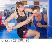 Купить «Young active woman exercise fight with man trainer», фото № 28590490, снято 21 августа 2017 г. (c) Яков Филимонов / Фотобанк Лори