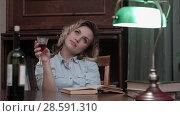 Купить «Young woman reading a book and enjoying a glass of red wine», фото № 28591310, снято 20 октября 2019 г. (c) Vasily Alexandrovich Gronskiy / Фотобанк Лори