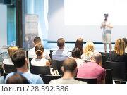 Купить «Business speaker giving a talk at business conference event.», фото № 28592386, снято 15 июня 2018 г. (c) Matej Kastelic / Фотобанк Лори