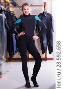 Купить «Woman is posing in new costume for diving», фото № 28592658, снято 25 января 2018 г. (c) Яков Филимонов / Фотобанк Лори