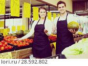 Купить «Happy sellers offering good price», фото № 28592802, снято 18 августа 2018 г. (c) Яков Филимонов / Фотобанк Лори