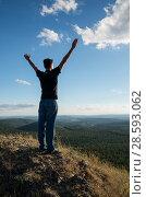 Человек на вершине горы. A man on top of a mountain. Стоковое фото, фотограф Евгений Романов / Фотобанк Лори