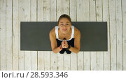 Купить «Sporty woman with joined hands in fitness studio», фото № 28593346, снято 27 мая 2020 г. (c) Vasily Alexandrovich Gronskiy / Фотобанк Лори