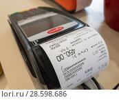 Купить «POS terminal with a receipt», фото № 28598686, снято 14 декабря 2019 г. (c) Антон Гвоздиков / Фотобанк Лори
