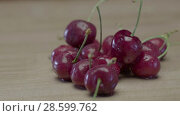 Купить «Wet Juicy Cherry Berries Lying On A Wooden Table», видеоролик № 28599762, снято 25 мая 2018 г. (c) Pavel Biryukov / Фотобанк Лори