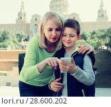 Купить «Cheerful mother and son looking at map guide», фото № 28600202, снято 18 марта 2017 г. (c) Яков Филимонов / Фотобанк Лори