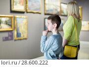 Купить «Mother and son regarding paintings in halls of museum», фото № 28600222, снято 18 марта 2017 г. (c) Яков Филимонов / Фотобанк Лори