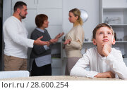 Купить «Unhappy boy during parents and grandma quarreling», фото № 28600254, снято 17 декабря 2017 г. (c) Яков Филимонов / Фотобанк Лори