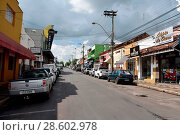 Купить «Stores, commerce, 2018, Rodolfo Guimarães Avenue, Center, city, Brotas, Sao Paulo, Brazil.», фото № 28602978, снято 10 марта 2018 г. (c) age Fotostock / Фотобанк Лори