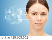 face of beautiful woman with low poly projection. Стоковое фото, фотограф Syda Productions / Фотобанк Лори