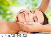 Купить «close up of beautiful woman having face massage», фото № 28605526, снято 25 июля 2013 г. (c) Syda Productions / Фотобанк Лори