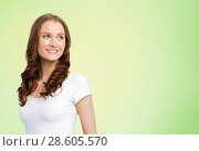 Купить «happy woman in white t-shirt over lime green», фото № 28605570, снято 17 апреля 2016 г. (c) Syda Productions / Фотобанк Лори