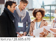 Купить «international business team with papers outdoors», фото № 28605670, снято 13 мая 2017 г. (c) Syda Productions / Фотобанк Лори