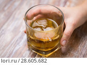 Купить «male hand with glass of alcohol on table», фото № 28605682, снято 24 ноября 2017 г. (c) Syda Productions / Фотобанк Лори