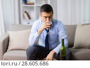 Купить «alcoholic drinking red wine at home», фото № 28605686, снято 24 ноября 2017 г. (c) Syda Productions / Фотобанк Лори