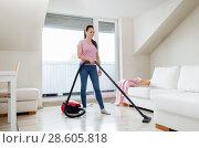 Купить «woman or housewife with vacuum cleaner at home», фото № 28605818, снято 29 апреля 2018 г. (c) Syda Productions / Фотобанк Лори