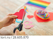 Купить «hands making heart decoration for gay party», фото № 28605870, снято 14 ноября 2017 г. (c) Syda Productions / Фотобанк Лори