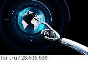 robot hand touching virtual earth hologram. Стоковое фото, фотограф Syda Productions / Фотобанк Лори