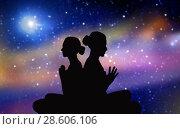 Купить «black silhouette of couple meditating over space», фото № 28606106, снято 6 августа 2014 г. (c) Syda Productions / Фотобанк Лори