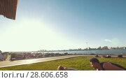 Купить «Cheerleaders team workout outdoors at summer day - young man drops the girl on the grass», видеоролик № 28606658, снято 22 июля 2018 г. (c) Константин Шишкин / Фотобанк Лори