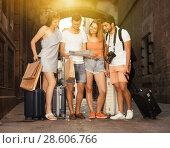 Купить «Portrait of tourists with map and baggage in European city», фото № 28606766, снято 22 июня 2017 г. (c) Яков Филимонов / Фотобанк Лори