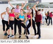 Купить «Active males and females dancing excited posing», фото № 28606854, снято 9 октября 2017 г. (c) Яков Филимонов / Фотобанк Лори