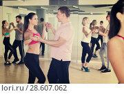 Купить «people having dancing class», фото № 28607062, снято 9 октября 2017 г. (c) Яков Филимонов / Фотобанк Лори