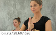 Beautiful women yoga trainer practicing in yoga class. Стоковое фото, фотограф Vasily Alexandrovich Gronskiy / Фотобанк Лори