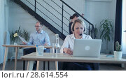 Купить «Beautiful call center agent having phone call and browsing the internet on her computer», видеоролик № 28614554, снято 8 июня 2017 г. (c) Vasily Alexandrovich Gronskiy / Фотобанк Лори