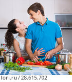 Купить «man and woman standing near table with vegetables», фото № 28615702, снято 26 июня 2019 г. (c) Яков Филимонов / Фотобанк Лори