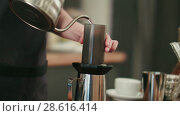 Barista adding grinded coffee and pouring hot water. Стоковое видео, видеограф Vasily Alexandrovich Gronskiy / Фотобанк Лори